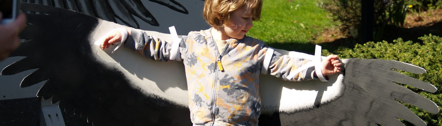 child measuring wingspan at Nadaka Park